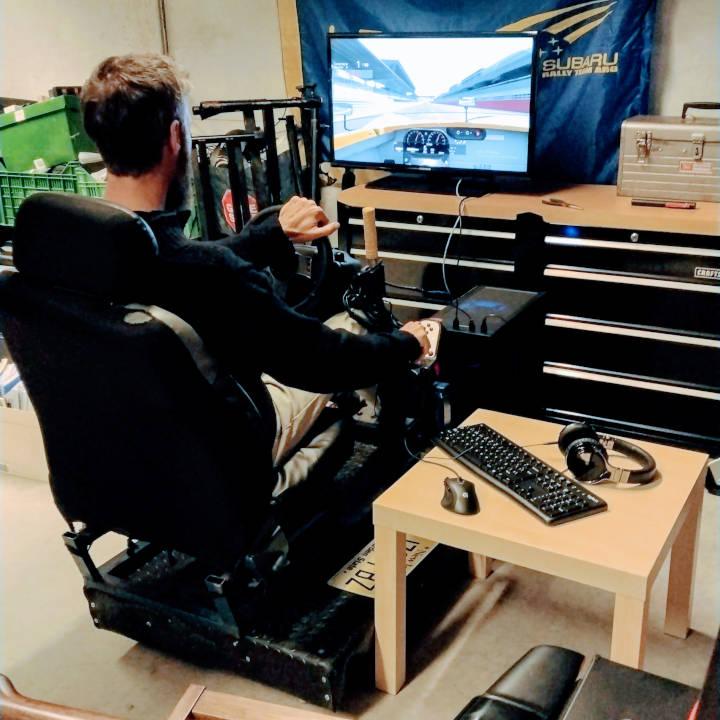 Photo of me playing Asseto Corsa on a racing simulator